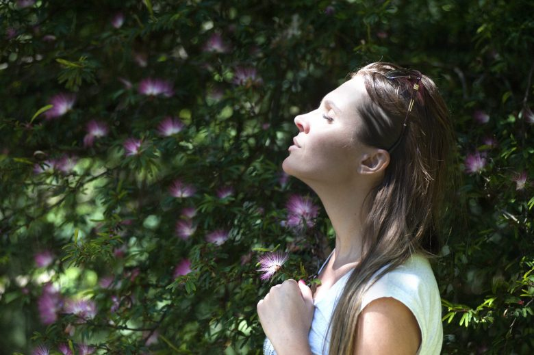 Woman in garden imagining the best possible world